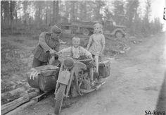 German motorcycle runner let Finnish kids play with his bike 1941.07.01 Raate road -  Finland
