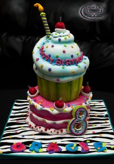 - This was my 3rd cake I made for Icing Smiles. It was for a little girl turning 8. The design is completely inspired by the famous Andrea's Sweetcakes. :)