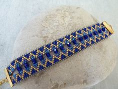 Cuff bracelet weaved royal blue golden and pearls with facets
