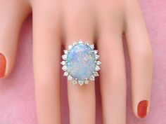 This ring is FABULOUS! The ring is centrally prong-set with 1 NATURAL FULL OPAL (not a doublet) that weighs approx. 10 CARATS. This CABOCHON CUT, FAT OVAL SHAPED OPAL has flashes of RED/ORANGE, GREENS & BLUES and it measures 19.27 mm long by 14.94 mm at the widest point. | eBay!