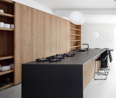 SIMPLE BENCHTOP WITH WATERFALL Dark Neolith Bench With Timber Veneer  Cabinetry
