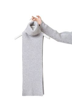 This grey chunky pure merino wool piece is an exceptional and versatile accessory to be worn over a tunic or casually thrown around the shoulders. The extra fine wool is achieved by a slow spinning process providing very even and smooth yarns. This piece is fully fashioned and suitable for home cold water hand wash. Produced in Slovakia Fabric origin: Italy Composition:melange grey 100% supergeelong two-end fine merino wool; GG 5; prewashed