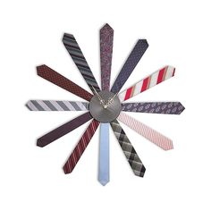 Tie clock $250 or make one yourself. I'd recommend opening up the ties and putting cardboard underneath the fabric and go from there.