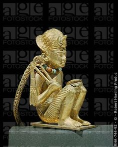 Ancient Egypt. 1350 B.C. Tiny solid gold statuette of King Amenophis III (Tutankhamun's grandfather) found in a small mummiform coffin in the tomb of the pharaoh Tutankhamun, discovered in the Valley of the Kings, Egypt. Tutankhamun had huge amounts of precious item stored with him to take into the next life. This golden statue was one of many.