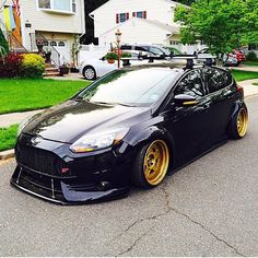 Ford Focus ST 2013, black colour and gold alloy wheels/rims , low suspension, tuning car
