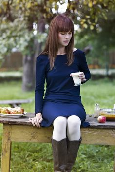 Simple dress in dark tone, white tights, neutral boots. Tights would just be a pop of white - not too much.