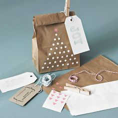 Paper Bag Gift Wrap Pack. LInk is to craft pack, but it can be done easily at home using a pencil eraser, white paint (or liquid paper) and a foil star sticker. I know, because I had to do it once when I ran out of treat bags. :)