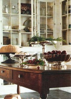 Antique wood island in a Gorgeous Kitchen with Glass doored cabinetry. I love these glass cabinets Beautiful Kitchens, Beautiful Homes, Beautiful Life, Farmhouse Kitchen Island, Rustic Kitchen, Country Kitchen, How To Antique Wood, Cottage Chic, Decoration