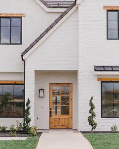 Becki Owens White Brick Home Wood Door