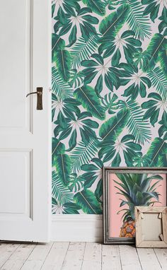 Ready for a tropical takeover? This tropical leaf wallpaper brings together beautiful illustrative foliage with vibrant emerald greens. Banish boring old walls in hallway spaces with this fun wallpaper design.
