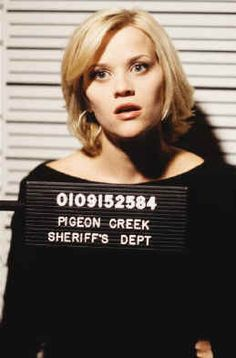 reese witherspoon mug shot & her hair still looks cute:)