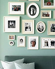 From Martha Stewart Living: Choose a single color of spray enamel or latex paint to coat all of your frames.  You can add to your collection through the years when you find inexpensive frames (of any color) by repainting them with your chosen color.