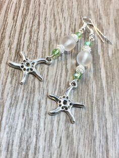 Silver Starfish Earrings What a beautiful pair of Beach Theme Earrings. I started with two clear gla #gulfcoasttreasure #seaglass
