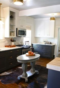 dark base cabinets, white upper cabinets, marble counters, microwave mounted about stove. Kitchen Dinning, Kitchen On A Budget, Kitchen Redo, New Kitchen, Kitchen Remodel, Dining, Kitchen Layout, Kitchen Ideas, Kitchen Board