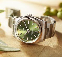 The olive green dial of the Rolex Oyster Perpetual 34 adds a dash of colour to a timeless Rolex classic.