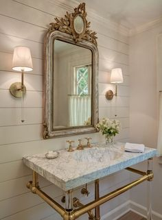 In Good Taste: Shelley Morris Interiors - lovely country bathroom with a gorgeous French mirror and marble and brass console sink