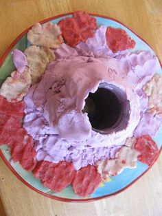 baking soda volcano from the artful parent.  Would be fun to put the mentos/soda thing inside too