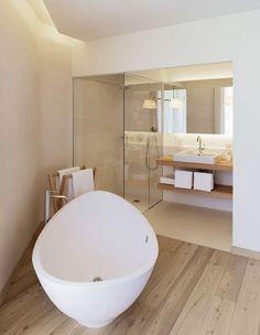 Modern Minimalist #Bathroom with Wood #Flooring - http://royalhouseinteriors.com/beauty-minimalist-bathroom-design/modern-minimalist-bathroom-with-wood-flooring/