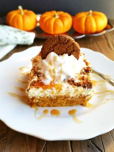 This Salted Caramel Pumpkin Poke Cake is super easy to make and soooo delicious! All it takes is a yellow cake mix, salted caramel sundae sauce, sweetened condensed milk, pumpkin and spice. The icing is a simple mixture of cool whip and vanilla pudding with ginger snaps. I am so obsessed with poking cakes right now...most of the best cakes that I have had are poke cakes. They bring a little bit more party to the party with added ingredients and moisture!