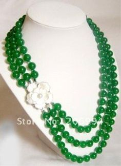 Image from http://img.alibaba.com/wsphoto/v0/509666298/Wholesale-genuine-10mm-green-jade-necklace-fashion-jewelry.jpg.