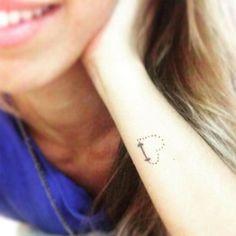 Heart dumbell tattoo