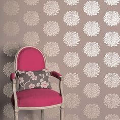 Contemporary wall paper and a pink chair