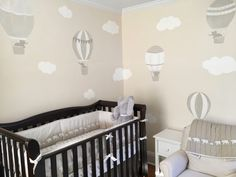 An up up and away nursery with a neutral mural of hot air balloons and elephants. I love the use of neutrals in this nursery. Nursery Wall Decals Boy, Clouds Nursery, Elephant Nursery, Nursery Rhymes, Baby Boy Rooms, Baby Boy Nurseries, Balloons, Balloon Wall, Nursery Hot Air Balloon