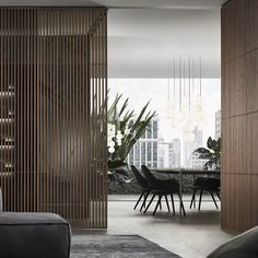 Rimadesio SAIL design schuifdeur van glas met vertikale aluminium profielen al dan niet gefineerd in walnotenhout. High-end Italiaans maatwerk via Noctum Projecten gespecialiseerd Rimadesio dealer - €