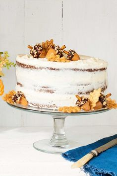 Decorate a nearly naked spice cakewith caramel acorns and piecrust leaves. Get the recipe.