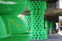 Using colourful plastic baskets or bowls to make a wall or columns