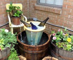 wine bottle fountain ~ wouldn't be hard to make, needs a glass under the flow ~    via http://www.rugsandblinds.com/wine-bottles-recycled-into-water-fountains.aspx