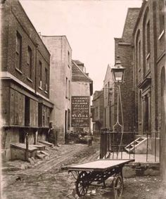 Fore Street at the junction with Ferry Street, Lambeth, 1860. Janeways's Pottery on the left, Diamond Hall, formerly Bishop of Hereford's Palace on the right. Replaced by the Albert Embankment c 1868