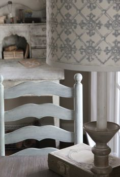 beautifully weathered desk and ladder back chair and painted shade