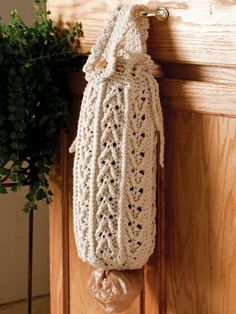 I like this even better!  Plastic Bag Holder. Can make using a sweater sleeve