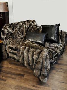 Raccoon Fur Armchair. Like I already don't spend enough time on the couch...