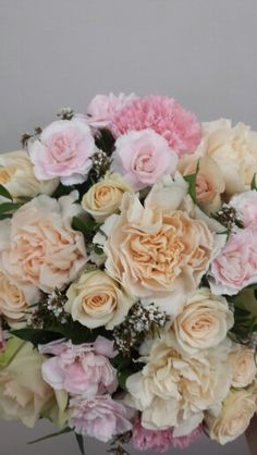 Carnations and champagne spray roses with accent of babies breath