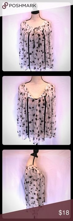Princess Vera Wang Black & White Blouse Princess Vera Wang Black & White Blouse. A+ condition. Sheer white with whimsical black flowers, gathered elastic deco across yoke and on décolleté'. Front has two black strings  with black tassels that tie or can be left open. .  Bishop sleeves with elastic gathering at wrist. Two strips of lace adorn the front. 100 polyester   Tunic is shown with a black cami that is not included. Princess Vera Wang Tops Blouses