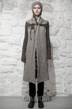 Daniel Andresen knee length sweater/ are the sleeves separate or not? either way-as a long vest and tie-able sleeves or a sweater that ties across from the sleeves-just fab!
