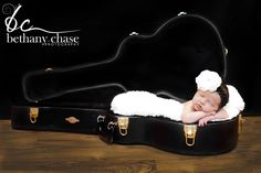 Newborn in guitar case @Tiffany Arnold   Idea for when you have another little Arnold?