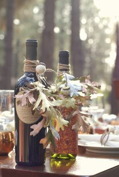 Wine is always a good hostess gift--but it's even more special when dressed up just a bit.  Spray painted leaves, a bit of twine, and a few felt acorns make these wine bottles look magnificent.
