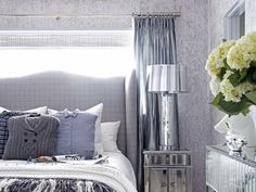 Trendy menswear fabrics, mirrored furniture and nature-inspired details come together effortlessly in this bedroom. A playful mix of finishes, patterns and textures starts with the bedding ensemble, then makes its way throughout the entire room. Bedroom Color Schemes, Bedroom Colors, Bedroom Ideas, Bedroom Pictures, Winter Bedroom Decor, Ideas Dormitorios, Sophisticated Bedroom, Mirrored Furniture, Mirrored Nightstand
