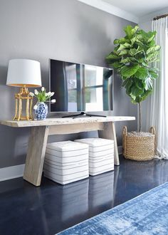 tv wall fiddle leaf fig in basket toulouse ottoman cubes black and white gold bamboo lamp blue vintage inspired rug gray accent wall summer home tour -1