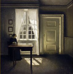 A Woman Sewing in an Interior - by Vilhelm Hammershoi