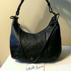 """Elliott Lucca Leather Intreccio Demi-Hobo Bag Amazing quality and style in this perfect sized bag.  Features a zip closure, a zippered pocket on the back, and two interior pockets.  Handle drop length is 10"""".  Removable and adjustable shoulder strap.  Gorgeous bag! Elliott Lucca Bags Hobos"""