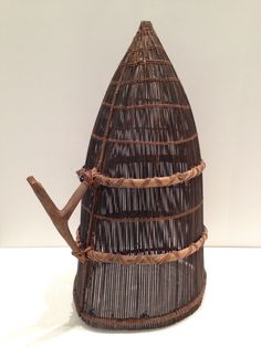 """Papua New Guinea basket from Nissan Island, this the largest of the """"green islands"""" off the coast, some 200 km northwest of Bougainville. This type of basket was used by women to catch small fish in the shallow lagoon off the bay."""