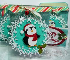 CottageCutz Jolly Penguin,  CottageCutz Winter Snowflake Wreath and CottageCutz Christmas Cheer Candles dies,  also the sentiment is from the Homemade Christmas Gift Set Box...
