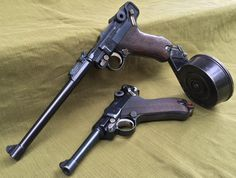 WWI Artillery Luger Lange P.08 with 32 round 9mm snail drum photographed above standard issue Luger