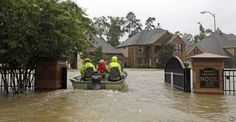 Rescuers enter a flooded subdivision  as floodwaters from Tropical Storm Harvey rise in Spring, Texas, Aug. 28, 2017.