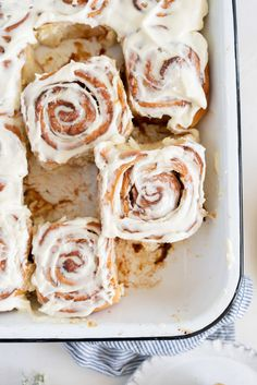 Rhubarb Sticky Buns - Brioche Spiked with vanilla, filled with rhubarb quick jam, and finished with a vanilla bean mascarpone frosting.