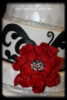 crazy cake, but love adding crystals in w those colors Sandras Cakes: Red, Black and White Wedding Cake